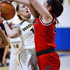 CARL RUSSO/Staff photo Andover's Amelia Hanscom fights her way to the basket against Central captain, Emily Downer. Central Catholic defeated Andover 60-37 in girls basketball action Tuesday night. 1/28/2020