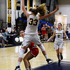 CARL RUSSO/Staff photo Central's captain, Juliana Porto keeps her eye on the basket and the right time to shoot as Andover's Anna Foley defends. Central Catholic defeated Andover 60-37 in girls basketball action Tuesday night. 1/28/2020