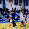 CARL RUSSO/Staff photo Andover's Kyle Rocker goes up for the basket as  Methuen's Jaleek Urena gives chase. Andover defeated Methuen 65-53 in boys' basketball action on Friday night. 1/24/2020