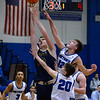 CARL RUSSO/Staff photo Andover's Aidan Cammann drives to the basket against Methuen's Mitchell Crowe, 20 and Anesti Touma. Andover defeated Methuen 65-53 in boys' basketball action on Friday night. 1/24/2020