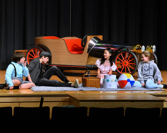 CARL RUSSO/Staff photo From  left:  Jonathan Oatman, 7th. grader as Jeremy Potts, Nate Allen, 8th. grader as Caratacus Potts, Alicia Zhang, 8th. grader as Truly Scrumptious and Aria Fraser, 6th. grader as Jemima Potts enjoy a picnic.<br /> <br /> The Wood Hill Middle School Drama Club will present  the musical Chitty Chitty Bang Bang on Friday, February 7th. at 7 pm and Saturday, February 8th. at 2 pm. Tickets are $10.00 in advance and $12.00 at the door.  1/31/2020