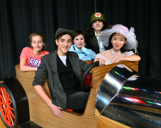 CARL RUSSO/Staff photo From row: Nate Allen as Caratacus Potts and Alicia Zhang as Truly Scrumptious. Both are 8th. graders. Back row: Aria Fraser, 6th. grader as Jemima Potts, Jonathan Oatman, 7th, grader as Jeremy Potts and Lucas Newmark-Ramirez, as Grandpa Potts.  Both are 7th. graders. The family takes Chitty Chitty Bang Bang out for a ride in the country.                <br /> <br /> The Wood Hill Middle School Drama Club will present  the musical Chitty Chitty Bang Bang on Friday, February 7th. at 7 pm and Saturday, February 8th. at 2 pm. Tickets are $10.00 in advance and $12.00 at the door.  1/31/2020