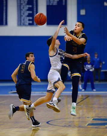 CARL RUSSO/Staff photo Andover's Kyle Rocker steals the ball from Methuen's Mitchell Crowe. Andover defeated Methuen 65-53 in boys' basketball action on Friday night. 1/24/2020