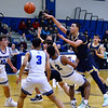 CARL RUSSO/Staff photo Andover's Kyle Rocker passes the ball over Methuen defenders. Andover defeated Methuen 65-53 in boys' basketball action on Friday night. 1/24/2020