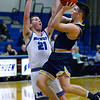 CARL RUSSO/Staff photo Andover's Charlie McCarthy drives to the basket against Methuen's Andrew Lussier. Andover defeated Methuen 65-53 in boys' basketball action on Friday night. 1/24/2020