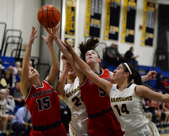 CARL RUSSO/Staff photo From left, Lily Angluin, Brooke Hardock, Claire Finney and Tatum Shaw battle for the loose ball. Central Catholic defeated Andover 60-37 in girls basketball action Tuesday night. 1/28/2020