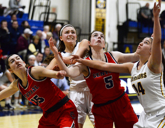 CARL RUSSO/Staff photo A variety of facial expressions, from left, Lily Angluin, Brooke Hardock, Claire Finney and Tatum Shaw as the players watch the loose ball sail above them. Central Catholic defeated Andover 60-37 in girls basketball action Tuesday night. 1/28/2020
