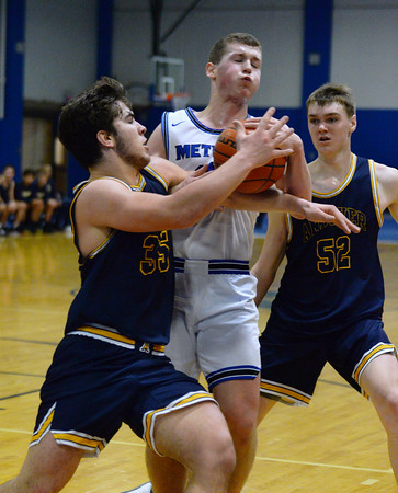 CARL RUSSO/Staff photo Andover's Michael Slayton fights for the loose ball Methuen's Andrew Lussier. Andover defeated Methuen 65-53 in boys' basketball action on Friday night. 1/24/2020