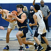CARL RUSSO/Staff photo. Andover's captain, Michael Slayton fights for the loose ball with Lawrence's Jeremiah Melendez. <br /> <br /> Unfortunately after a hard fought game, Andover was defeated by Lawrence 67-63 in boys' basketball action Tuesday night. 1/14/2020