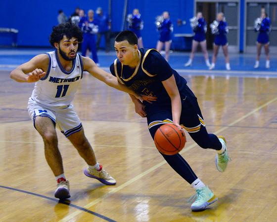CARL RUSSO/Staff photo Andover's Kyle Rocker drives to the hoop against Methuen's Jaleek Urena. Andover defeated Methuen 65-53 in boys' basketball action on Friday night. 1/24/2020