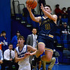CARL RUSSO/Staff photo Andover's Charlie McCarthy sails to the basket against Methuen's Mitchell Crowe. Andover defeated Methuen 65-53 in boys' basketball action on Friday night. 1/24/2020