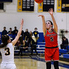CARL RUSSO/Staff photo Central's Claire Finney takes the three point jump shot over Andover's Marissa Kobelski. Central Catholic defeated Andover 60-37 in girls basketball action Tuesday night. 1/28/2020