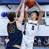 CARL RUSSO/Staff photo. Lawrence's Jeremiah Melendez takes the jump shot over Andover's Aiden Cammann. <br /> <br /> Unfortunately after a hard fought game, Andover was defeated by Lawrence 67-63 in boys' basketball action Tuesday night. 1/14/2020