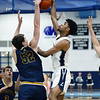 CARL RUSSO/Staff photo. Andover's Aidan Cammann blocks Lawrence's captain, Gabriel Zorrilla's drive to the basket. <br /> <br /> Unfortunately after a hard fought game, Andover was defeated by Lawrence 67-63 in boys' basketball action Tuesday night. 1/14/2020