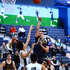 CARL RUSSO/Staff photo. Andover captain, Kyle Rocker takes the long three point jump shot surrounded by Lawrence defenders. <br /> <br /> Lawrence defeated Andover 67-63 in boys' basketball action Tuesday night. 1/14/2020