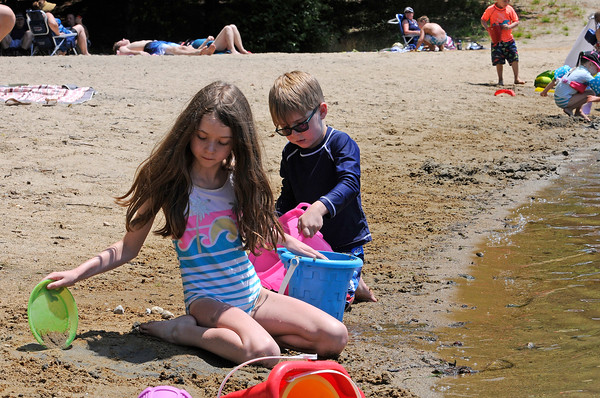 TIM JEAN/Staff photo<br /> <br /> Rielyn Leany, 10, plays in the sand with her brother Finn, 5, at Andover's Pomps Pond. The pond is officially open for the season with restrictions because of the coronavirus.     7/2/20