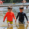 TIM JEAN/Staff photo<br /> <br /> Hudson Dascoli, 4, left, and his brother Cole 6, chase small fish along the shoreline at Andover's Pomps Pond. The pond is officially open for the season with restrictions because of the coronavirus.     7/2/20