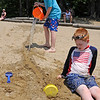 TIM JEAN/Staff photo<br /> <br /> James Collins, 10, pours water down a chute in the sand towards his brother Charlie 7, at Andover's Pomps Pond.   7/2/20
