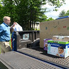 CARL RUSSO/Staff photo With some help from her family, Peyton Levental, 16, of Andover collected a large amount of food donations and money that was delivered to her house during the pandemic.  Tom Schauer, youth director for Faith Lutheran Church in Andover  helps to load up the truck.<br /> <br /> The food was delivered by her family and Tom Schauer, youth director for Faith Lutheran Church in Andover to the Lazarus House in Lawrence on Monday (6/1). Peyton will be a junior in the fall at Andover high school. 6/01/2020