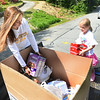 CARL RUSSO/Staff photo With some help from her family, Peyton Levental, 16, of Andover (seen here with her sister Colby, 8) collected a large amount of food donations and money that was delivered to her house during the pandemic. <br /> <br /> The food was delivered by her family and Tom Schauer, youth director for Faith Lutheran Church in Andover to the Lazarus House in Lawrence on Monday (6/1). Peyton will be a junior in the fall at Andover high school. 6/01/2020