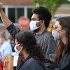 CARL RUSSO/Staff photo Max Vale of Wilmington, sophomore at Carleton College in Minn. raises his fist in support of Black Lives Matter. A crowd of about 500 people attended a rally in Shawsheen Square in Andover Monday evening to honor George Floyd and all victims of police violence. 6/01/2020