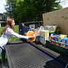 CARL RUSSO/Staff photo With some help from her family, Peyton Levental, 16, of Andover collected a large amount of food donations and money that was delivered to her house during the pandemic. <br /> <br /> The food was delivered by her family and Tom Schauer, youth director for  Faith Lutheran Church in Andover to the Lazarus House in Lawrence on Monday (6/1). Peyton will be a junior in the fall at Andover high school. 6/01/2020