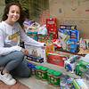 CARL RUSSO/Staff photo. With some help from her family, Peyton Levental, 16, of Andover collected a large amount of food donations and money that was delivered to her house during the pandemic. <br /> <br /> The food was delivered by her family and Tom Schauer, youth director for Faith Lutheran Church in Andover to the Lazarus House in Lawrence on Monday (6/1). Peyton will be a junior in the fall at Andover high school. 6/01/2020