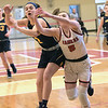 TIM JEAN/Staff photo <br /> <br /> Andover's Shea Krekorian, left, battles for the loose ball against Central's Claire Finney during girls basketball Division 1 North quarterfinals.    2/29/20