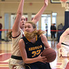 TIM JEAN/Staff photo <br /> <br /> Andover's Anna Foley, right, looks to score against Central's Emily Downer during girls basketball Division 1 North quarterfinals.    2/29/20