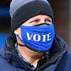 CARL RUSSO/Staff photo. Andrew Szendey sends a message after voting at the high school. Andover residents voting at Precincts 2, 7, including sub-precinct 7A, 8 and 9 at the Andover High School Richard J. Collins Field House. 11/03/2020