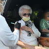 """CARL RUSSO/staff photo. Lena DeSimone of North Andover receives her flu shot from Lisa Slattery, Andover school nurse, from inside her nephew's pickup truck, Al Crafts, right, after he received his flu shot. The Andover Health Division Department accommodated the senior citizens who would have trouble walking to the clinic.  Approximately 280 people by appointment received their flu shots on Wednesday, October 7.  <br /> <br /> The Andover Health Division Department offered two """"High-Dose"""" Flu Clinics for Seniors, 65 yrs. and older, at the Bancroft Elementary School, on Wednesday, October 7th and Wednesday, October 14th, from 9 a.m. to 12 noon, by appointment only. 10/7/2020"""