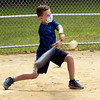 TIM JEAN/Staff photo<br /> <br /> Max Bulter, 9, drives the ball for a hit while playing a whiffle ball game during a summer camp program run by Andover Recreation Department held at Recreation Park.    8/26/20