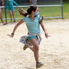 TIM JEAN/Staff photo<br /> <br /> Rachel Berthelsen, 9, runs down the first base line after hitting the ball while playing a whiffle ball game during a summer camp program run by Andover Recreation Department held at Recreation Park.    8/26/20
