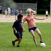 TIM JEAN/Staff photo<br /> <br /> Noboru Takeuchi, 11, left, battles for the soccer ball with camp councilor Molly Pritchard, 17, during a summer camp program run by Andover Recreation Department held at Recreation Park.    8/26/20