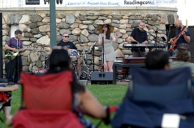 TIM JEAN/Staff photo  A crowd gathers to listen to the Katrina Marie Band perform during Andover's Concerts in the Park series. The concert was a makeup one due till the weather.  8/22/19