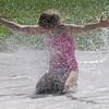 TIM JEAN/Staff photo<br /> <br /> After Hiking in an AVIS Reservation around town Maggie O'Handley cools off on the slip N slide behind the Cormier Youth Center. The center has reopened but many activities are in small groups outside doing actives like hiking, biking, and kayaking.    7/29/20