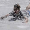 TIM JEAN/Staff photo<br /> <br /> After biking around town Calvin Paul cools off on the slip N slide behind the Cormier Youth Center. The center has reopened but many activities are in small groups outside doing actives like hiking, biking, and kayaking.    7/29/20