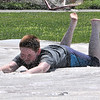TIM JEAN/Staff photo<br /> <br /> After biking around town Colin Bouley cools off on the slip N slide behind the Cormier Youth Center. The center has reopened but many activities are in small groups outside doing actives like hiking, biking, and kayaking.    7/29/20