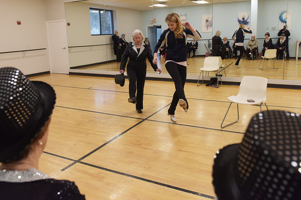 TIM JEAN/Staff photo <br /> <br /> Audrey Nason, left, teaches Jonalyn Saxer, a professional dancer from Broadway's Mean Girls a dance number while she stopped by to visit with members of the Sunset Tappers during a their weekly gathering at Dance Infusion in Andover.   2/5/20
