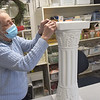 TIM JEAN/Staff photo<br /> <br /> Shirley Howe adds the price to a marble pedestal before putting it on the floor for sale at the Andover Thrift Shop. The shop, a Ministry of the Parish of Christ Church is celebrating its 80th birthday this February.   2/3/21