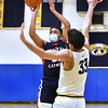CARL RUSSO/staff photo Central's Marcus River takes the jump shot over Andover's Ryan Grecco. Andover high Warriors defeated Central Catholic Raiders 60-57 is the first boys basketball game of the season. 1/12/2021