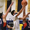 CARL RUSSO/staff photo Central's Jermaine Wiggins, right and Central's Isaac Bonilla double team trying to stop Andover's Zayn Aruri as he sails to the hoop. Andover high Warriors defeated Central Catholic Raiders 60-57 is the first boys basketball game of the season. 1/12/2021