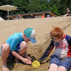 TIM JEAN/Staff photo<br /> <br /> James Collins, 10, left, and his brother Charlie 7, dig out a chute in the sand at Andover's Pomps Pond.   7/2/20