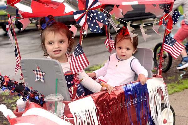 TIM JEAN/Staff photo<br /> <br /> Caroline Tokarz, 3, left, of Andover, and her sister Molly, 1, enjoyed the ride in a decorated wagon during the annual July 4th Horribles Parade in Andover. The route was changed this year and started in front of Town Hall on Bartlett St., right onto Chestnut, then right on to Whittier Court and then into the park where it ended.   7/4/21