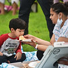 CARL RUSSO/Staff photo. Deepika Kulkarni of Andover feeds her son Neil, 4, a slice of pizza while attending Indian Night.<br /> The Town of Andover's Community Services Department   invites friends and neighbors for a new Monday Nights on the Common series Celebrating and highlighting the many different cultures in our community. <br /> The events are free and open to the public.<br /> <br /> On Monday, July 19, Indian Night featured Seema Gupte, a science teacher at Andover high school, who demonstrated the ancient art form of Henna Art. The event attracted about 30 people who also came to watch the  Indian movie, Dangal. <br /> <br /> Dangal is a biography of a real life patriotic fighter Mahavir Singh Phogat who raises his daughters and evolves them into World Class Fighters. <br /> <br /> Monday nights on the Common continues on Monday, July 26, 7:00 pm Celebrating Chinese Culture. Activities in Chinese Zither, GongFu demonstration, jump rope performance, calligraphy and paper cutting activities and traditional Chinese games. The movie Monster Hunt will be shown.<br /> 7/19/2021
