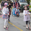 TIM JEAN/Staff photo<br /> <br /> Havel McCabe, 9, left, of Andover, and her sister Violet decorated their scooters and dressed in red, white and blue dresses to make part in the annual July 4th Horribles Parade in Andover. The route was changed this year and started in front of Town Hall on Bartlett St., right onto Chestnut, then right on to Whittier Court and then into the park where it ended.   7/4/21