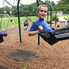 TIM JEAN/Staff photo<br /> <br /> Cameron Quinlan, 6, right, and his brother Calvin, 4, and their sister Caroline, 2, enjoys swings after the rain stops in the Penguin Park Playground in Andover, Tuesday afternoon.     7/13/21