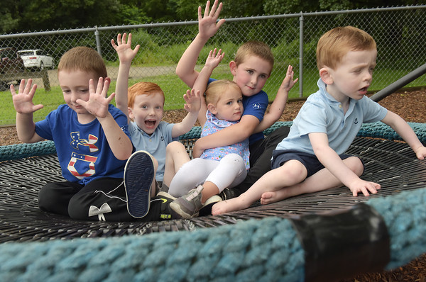 TIM JEAN/Staff photo<br /> <br /> Enjoying the weather outside are from left, to right, Calvin Quinlan, 4, Eddie Evans, 5, Caroline Quinlan, 2, her brother Cameron, 6, and Grady Evans, 2, on the big basket swing in the Penguin Park Playground in Andover, after the heavy rains stopped on Tuesday afternoon.     7/13/21