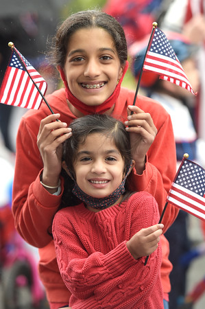 TIM JEAN/Staff photo<br /> <br /> Shambhavi Desai, 11, of Andover, and her sister Bhargavi, 5, show off there patriotic spirit during the annual July 4th Horribles Parade in Andover. The route was changed this year and started in front of Town Hall on Bartlett St., right onto Chestnut, then right on to Whittier Court and then into the park where it ended.   7/4/21