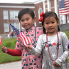TIM JEAN/Staff photo<br /> <br /> Connor Vicente, 6, left, of Andover, and his sister Isabelle, 5, show off there patriotic spirit after marching in the July 4th Horribles Parade in Andover. The route was changed this year and started in front of Town Hall on Bartlett St., right onto Chestnut, then right on to Whittier Court and then into the park where it ended.   7/4/21